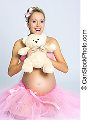 Pregnant girl with teddy bear - Beautiful young pregnant...