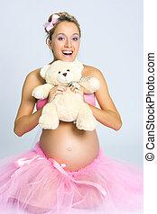 Pregnant girl with teddy bear