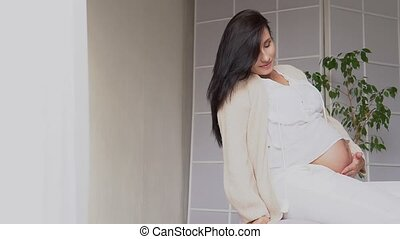 pregnant mom in a white room