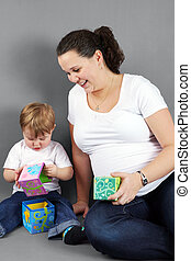 Pregnant mom playing with little boy