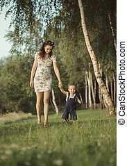 Pregnant mom walking with child
