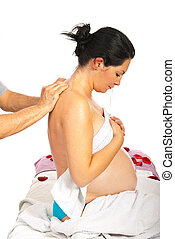 Pregnant receiving back massage - Pregnant woman receive...