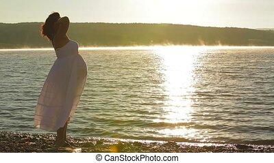 Pregnant Silhouette Admiring The Dawn Sun. - Belly of a...