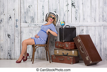 Pregnant tourist with suitcases - Stylish pregnant lady...