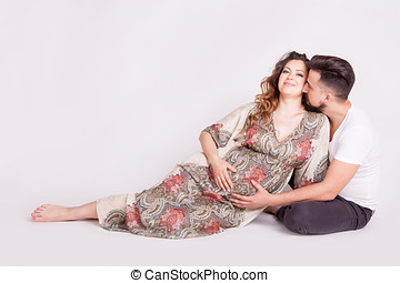 Pregnant wife next to her husband
