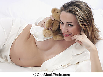pregnant with bear in bed