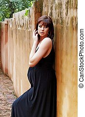 pregnant woman against grunge wall