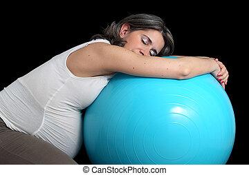 Pregnant woman and gym ball