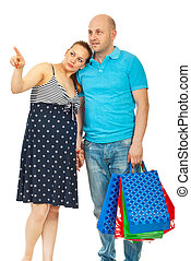 Pregnant woman and husband at shopping