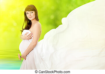 pregnant woman and pink daisy flower