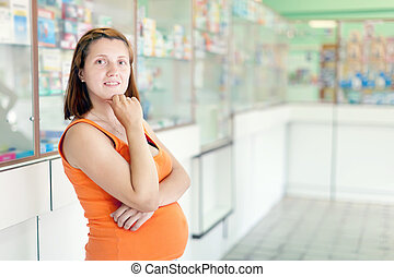 pregnant woman at pharmacy