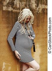 pregnant woman at the wall