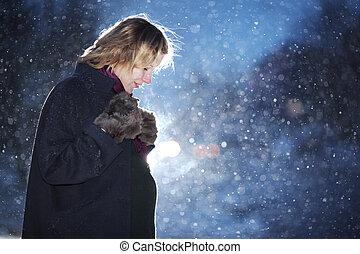Pregnant woman at winter