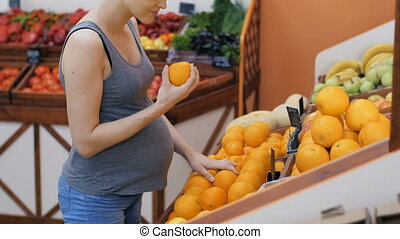 Pregnant Woman Buying Fruits