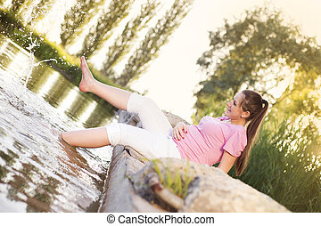 Pregnant woman by the lake
