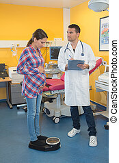 pregnant woman consulting a doctor for routine examination
