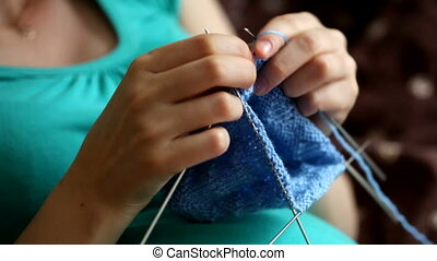 Pregnant woman crocheting for baby during pregnancy. Crochet, knitting process