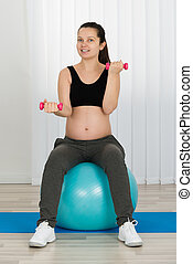 Pregnant Woman Doing Exercise On Fitness Ball