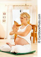Pregnant woman doing pregnancy yoga - Pregnant woman ...