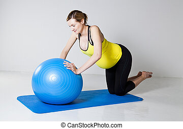 Pregnant woman doing push-up exercise