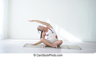 pregnant woman doing sport exercises Yoga