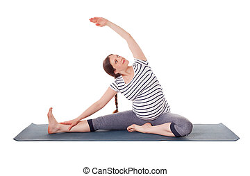 sporty young woman practicing yoga revolved head to knee