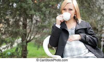 Pregnant woman drinking tea