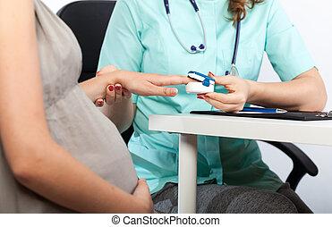 Pregnant woman during pulse measurement