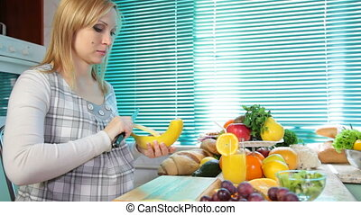Pregnant woman eating a banana
