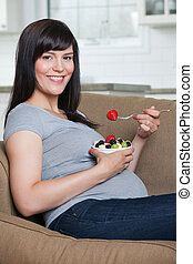 Pregnant Woman Eating Fruit Salad