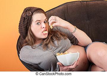 Pregnant Woman Eats Potato Wafers - Pretty pregnant woman...