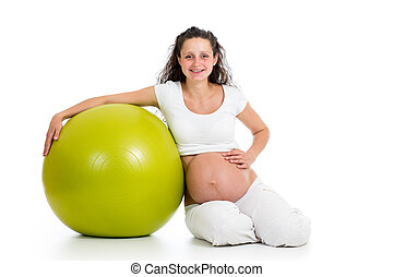 Pregnant woman excercises with gym ball