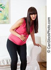 Pregnant woman feeling pain