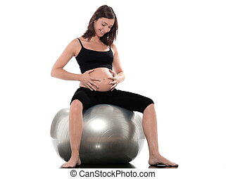 Pregnant Woman Happy sitting on swiss ball fitness -...