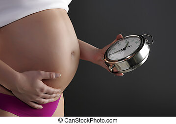 Pregnant woman holding a