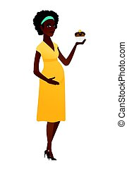 Pregnant woman holding a cupcake.