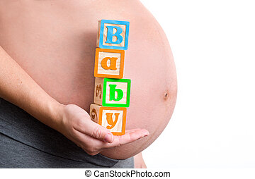Pregnant woman holding baby word