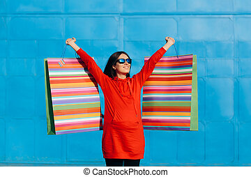 Pregnant Woman Holding Huge Shopping Bags