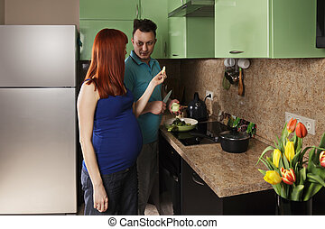 Pregnant woman holds apple slice
