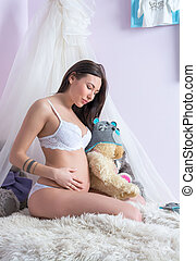 Pregnant woman in bed