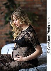 Pregnant woman in black dress