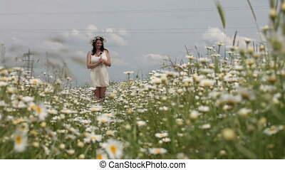 Pregnant woman in spring  field
