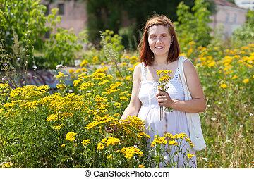 woman in tansy plant
