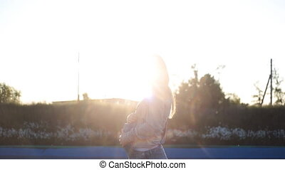 Pregnant woman in the summer nature meadow with in sunset