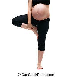 Pregnant woman in yoga pose isolated on white background