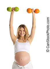 Pregnant woman involved in fitness dumbbells made from ...