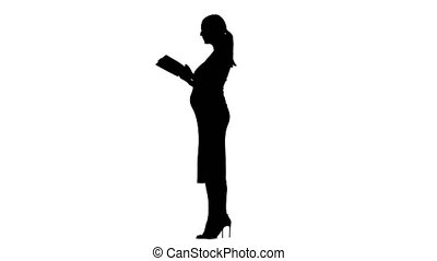 Pregnant woman is reading a book. Silhouette. White background. Slow motion