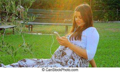 Pregnant woman listening music