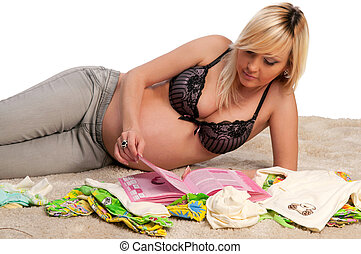pregnant woman lying on the carpet
