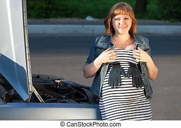 Pregnant Woman Near the Broken Car